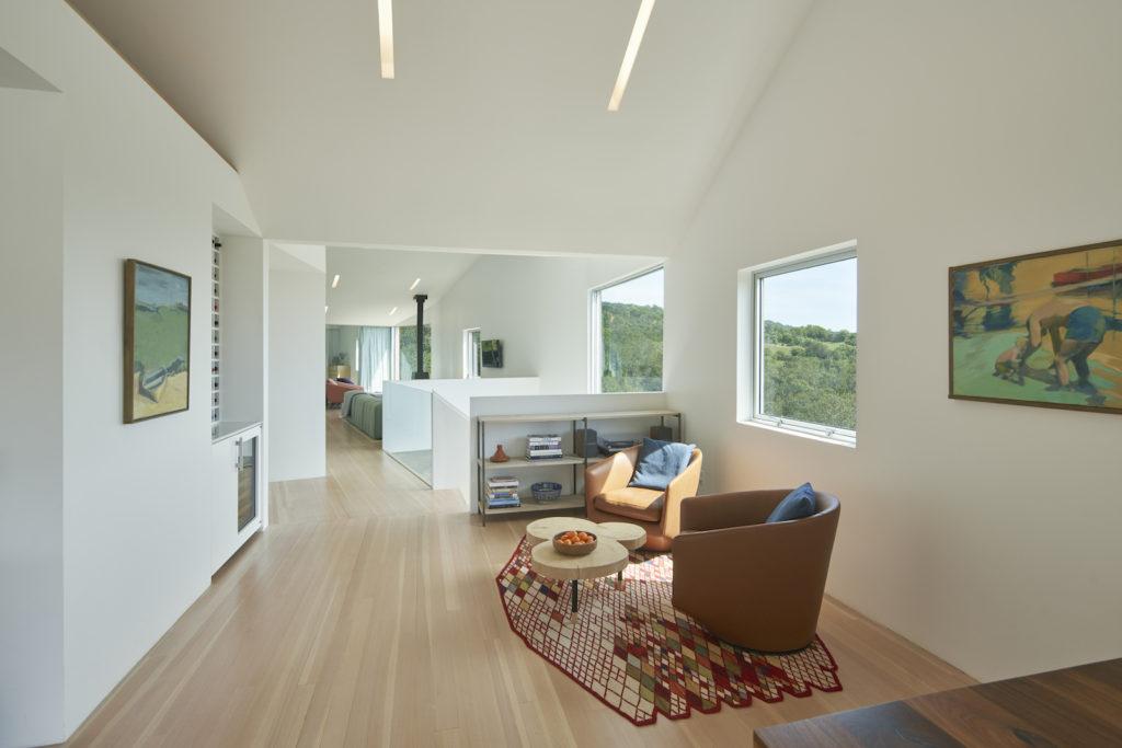 Triple Barn House interior with views